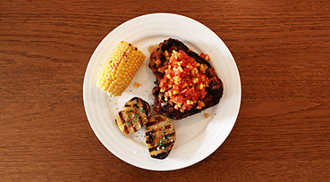 Svine T-Bone på grill med mango salsa og grill-kartoffel